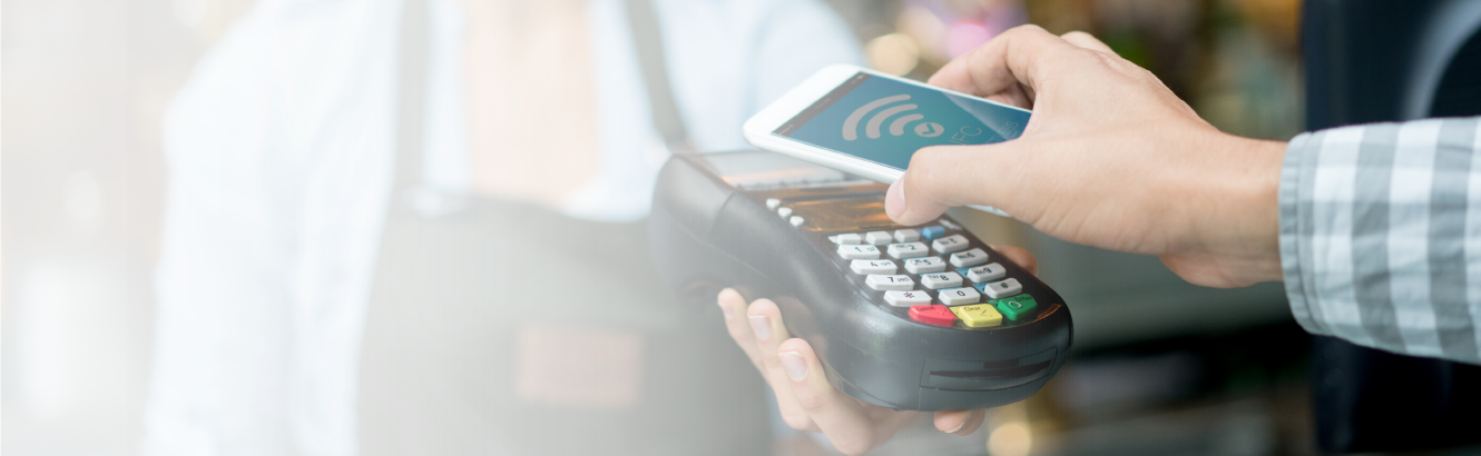 Making a contactless payment with a cellphone.